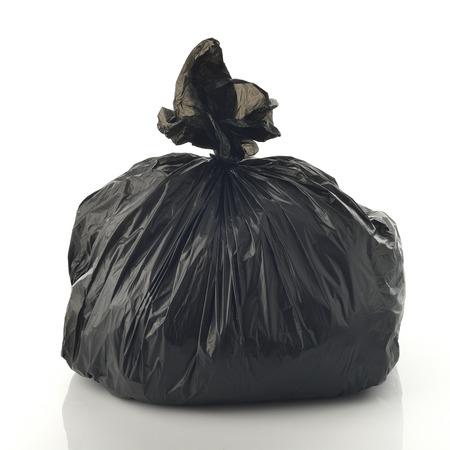 black plastic garbage bag: Trash Bag on White Background Shot in Studio