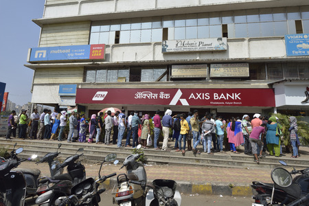 five rupee: Mumbai, India - November 12, 2016: People standing in long queue to withdraw money from banks after demonetization of  Rs.500 and Rs.1000 Indian currency notes