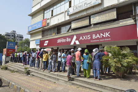 inconvenience: Mumbai, India - November 12, 2016: People standing in long queue to withdraw money from banks after demonetization of  Rs.500 and Rs.1000 Indian currency notes