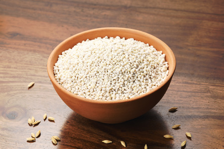Close up of Pearl Barley in a Earthen Bowl on Wooden Background