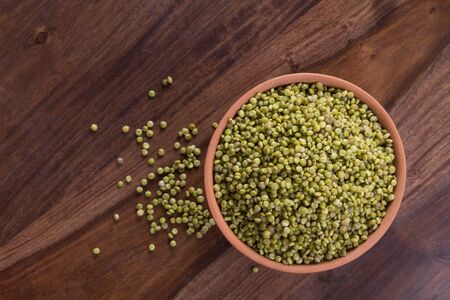 Top View of Fresh Green Tender Sorghum in a Earthen Bowl on Wooden