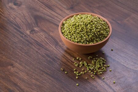 Fresh Green Tender Sorghum in a Earthen Bowl on Wooden