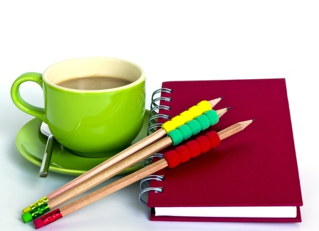 cup of coffee and notebook with 3 pencil in white background photo