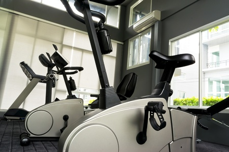 Room with gym equipment in clubhouse