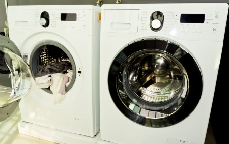 some clothes in an open washing machine Stock Photo