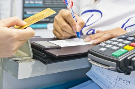 woman customer shopping in department store and paying by credit card Standard-Bild