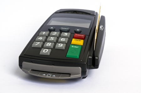 pos: Credit card and card  reader on white background