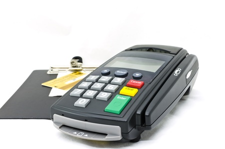 Credit card reader machine and Sale slip on Writing Pad,isolated on white