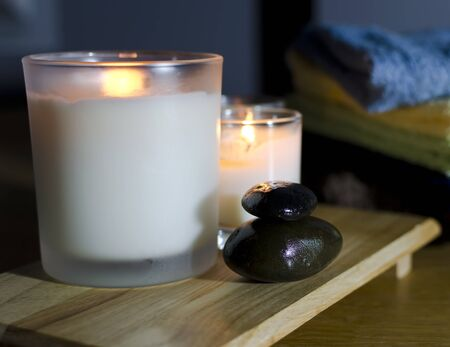aromatherapy spa treatment with aroma candle and hot stone Stock Photo