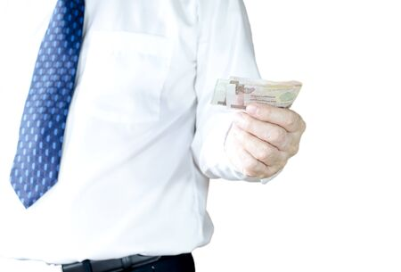 bussiness man: bussiness man holding Bank note for payment, isolated on white background Stock Photo