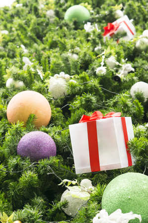 Decorative Christmas balls and gift box on Christmas tree,selective focus photo