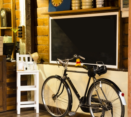 Vintage style wood coffee shop and old bicycle