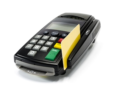 Credit card reader machine and gold credit card swipe ,isolated on white background Stock Photo - 16892812
