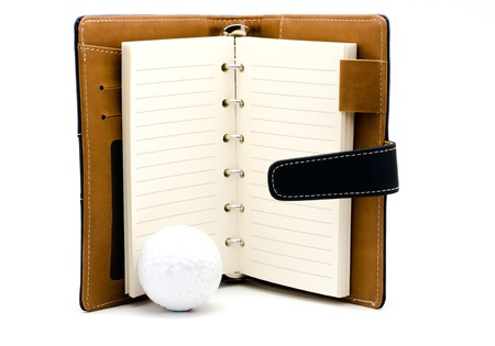 Open blank note book and golf ball  ,isolated on white background Stock Photo