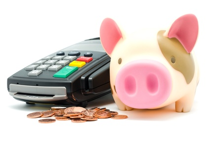 Credit card reader machine ,Piggy Bank and Copper coins,isolated on white background photo