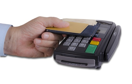Hand showing credit card on credit card reader machine photo