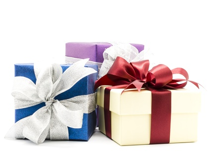 Three gift boxes decorated with ribbon isolated on white background. Stock Photo