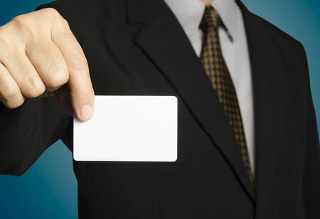 Business man showing a blank card,isolated background