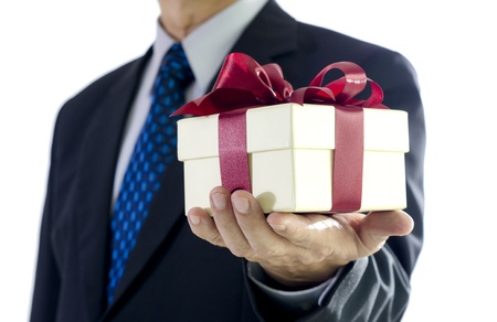 Business man holding a gift box on white background Standard-Bild