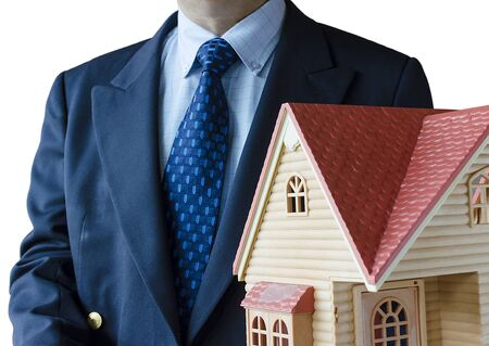 Business man with house model on hand- real estate concept.