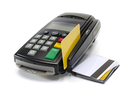 Credit card reader machine and blank credit card on white background photo