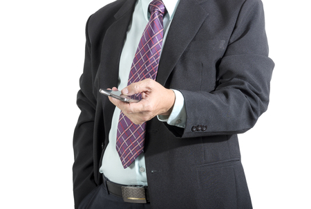 Businessman using mobile phone ,isolated on white background photo