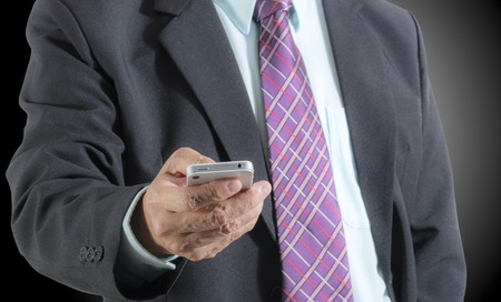 Close up of businessman using mobile phone , isolated  background photo