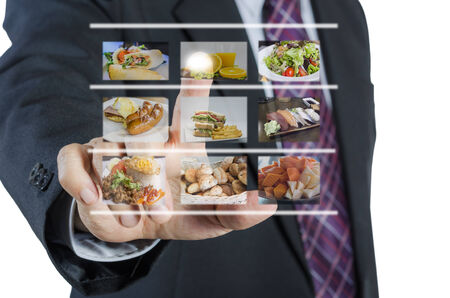 Businessman push virtual button screen in restaurant,isolated on white background Stock Photo
