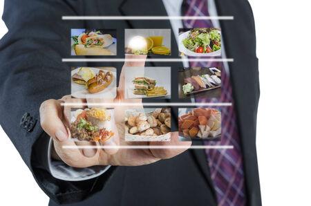 Businessman push virtual button screen in restaurant,isolated on white background Standard-Bild