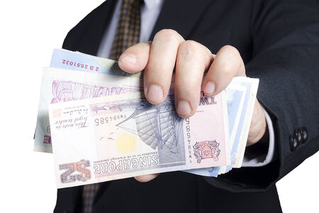 businessman showing packs of international bank note Stock Photo - 24896229