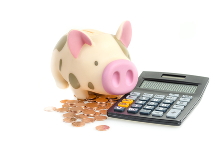 Piggy bank and Coins with calculator,Isolated on white background Stock Photo