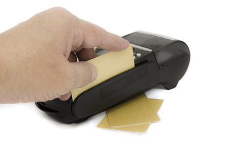 Close up of businessman hand insert credit card in credit card reader machine photo