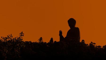 Silhouette the Tian Tan Buddha in Hong Kong photo
