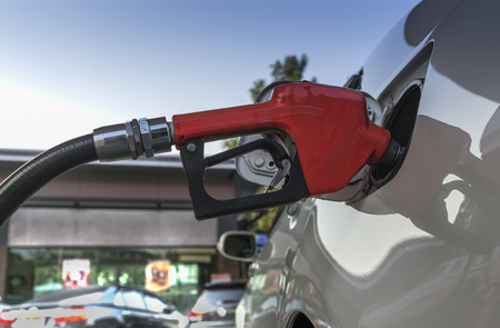 Refueling car with gasoline at gas station