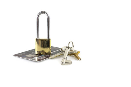 Credit card with a padlock and key , isolated on white background photo