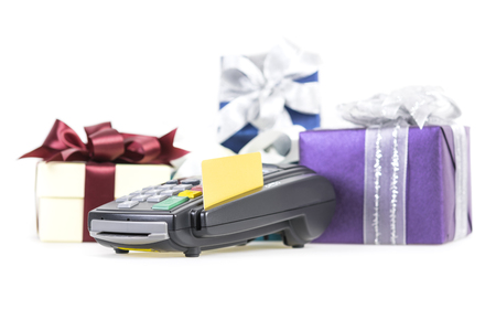 Credit card and card reader machine and  gift box on background ,isolated on white background photo