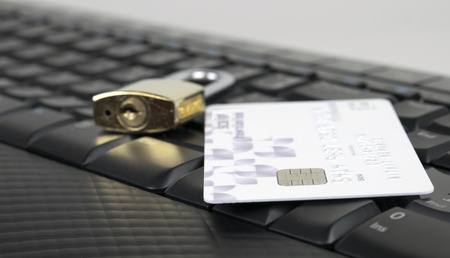 Credit card and Key on computer keyboard , Concept for online carefully photo