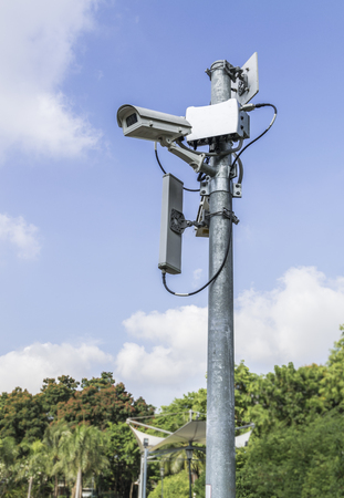 closed circuit: Security surveillance cameras in the park :CCTV Stock Photo