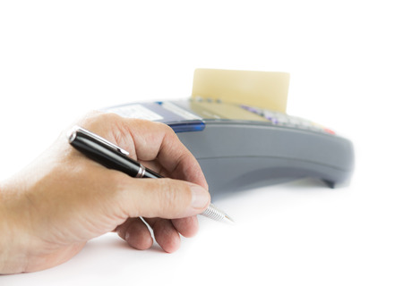 Prepare to write signature when use credit card, focus on hand photo