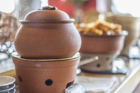 clay pot: Buffet heated clay pot ready for service Stock Photo