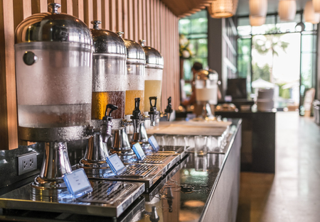 cater: Row of fresh juice at buffet restaurant Stock Photo