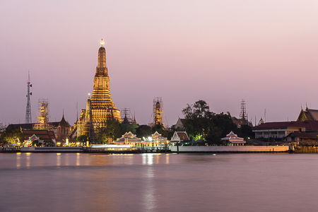 chao phraya river: Twilight time of Wat Arun across Chao Phraya River during sunset in Bangkok, Thailand Stock Photo
