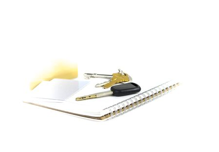 lock out: Car keys and credit card on book , prepare for travelling Stock Photo