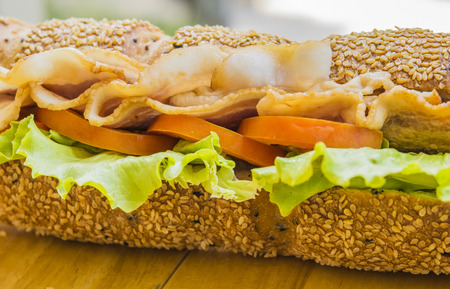 crusty french bread: Close up of ham and cheese salad submarine sandwich