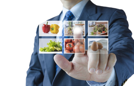 Businessman push virtual button screen select healthy foods menu,isolated on white background Standard-Bild