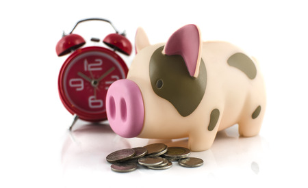 retirement homes: Piggy bank,coins and alarm clock ,time to save money for retirement