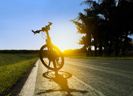 Silhouette of mountain Bike in the morning Stock Photo