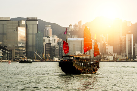 hong kong harbour: Hong Kong harbour with tourist junk in the morning
