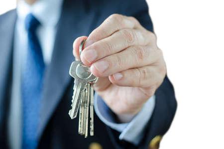thumb keys: Businessman and key , Isolated on white background