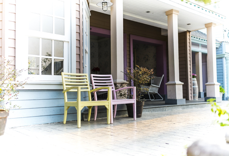 affluence: View of a large front porch with wood chairs Stock Photo